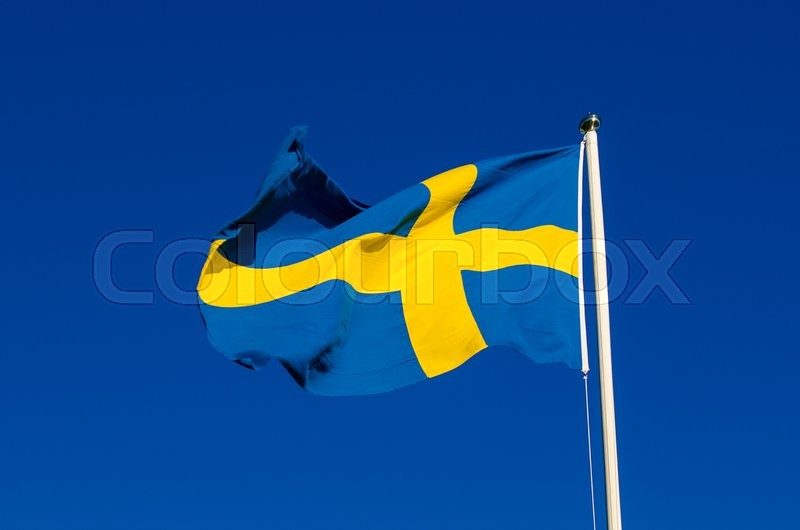Stock image of 'Flag of Sweden against the blue sky, national patriotic background'