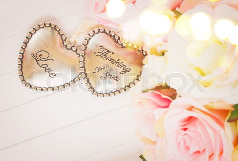 Stock image of 'Pair of Hearts with pink roses on white background, retro toned, retro toned'