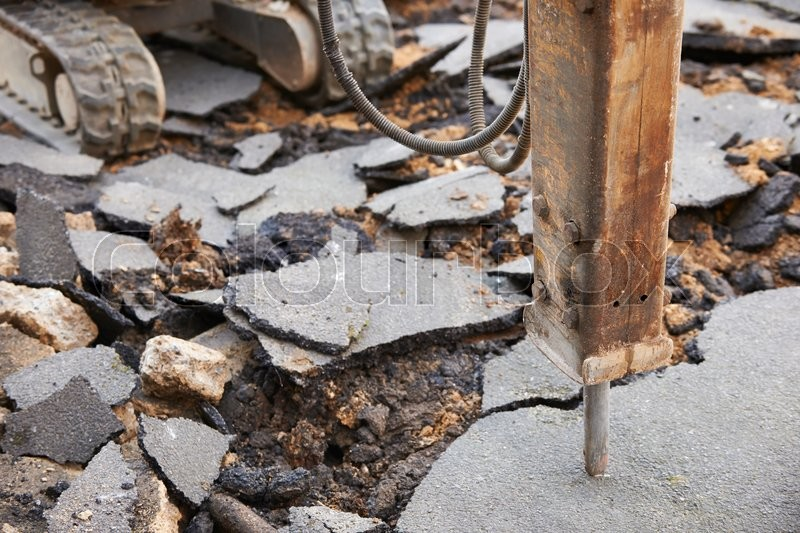 Stock image of 'Close Up Of Jackhammer Breaking Up Road Surface'