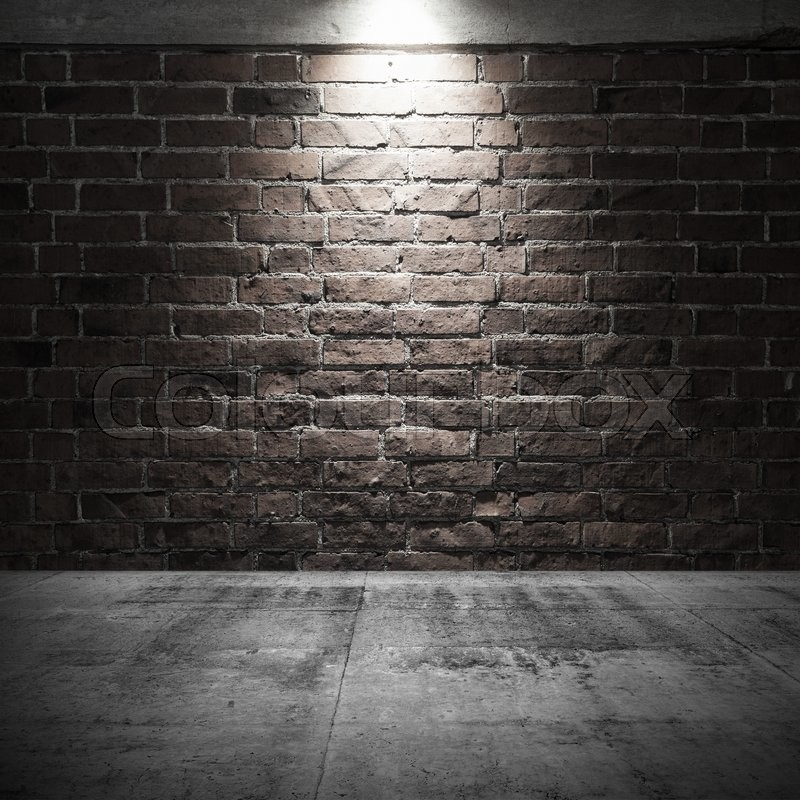 Abstract Dark Interior Background With Concrete Floor And Brick Wall Spot Light Illumination