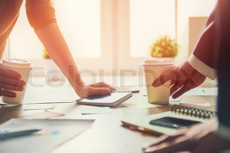 Stock image of 'Working day in office. two businessmen at work.'