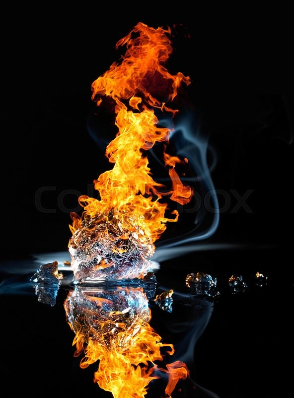 Stock image of 'studio photography of a burning ice crystal and smoke in black reflective back'
