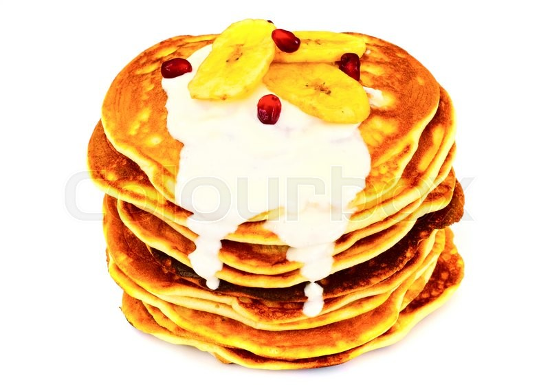 Stock image of 'Pancake with Banana, Pomegranate and Sour Cream Studio Photo'