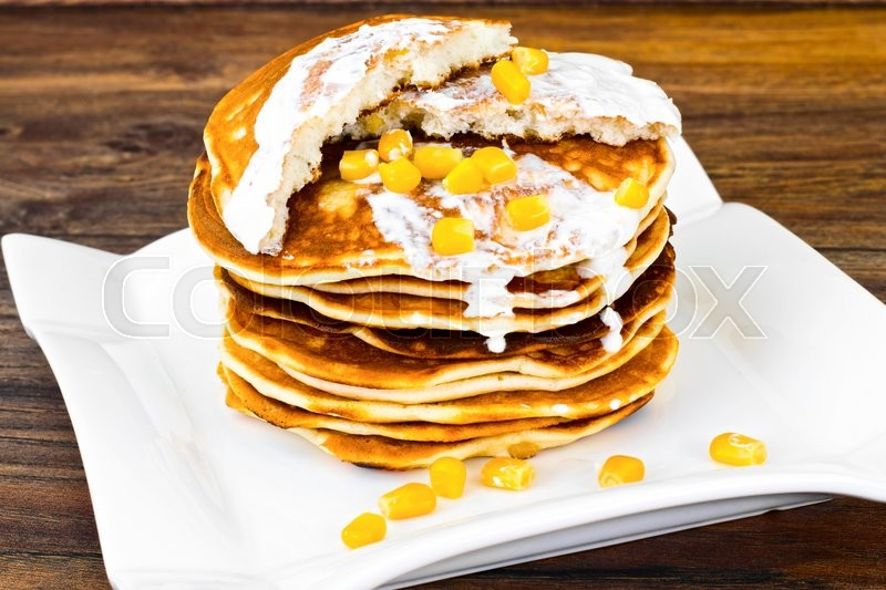 Stock image of 'Tasty Pancakes Stack with Sweet Corn Studio Photo'