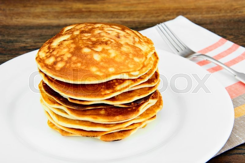 Stock image of 'Tasty Pancakes Stack on Plate. Studio Photo'