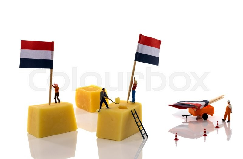 Stock image of 'little people putting the dutch red white and blue flags on dutch cheese'