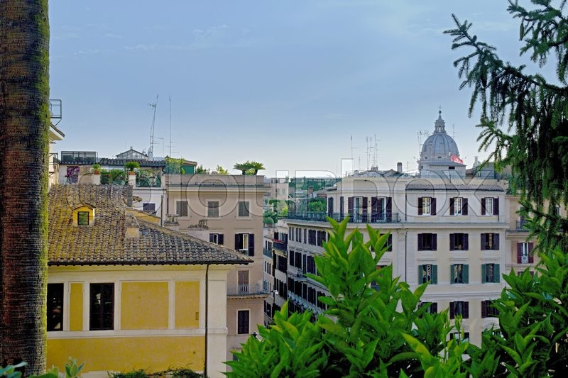 Stock image of 'Photo shows Rome cityscape with houses and roofs.'
