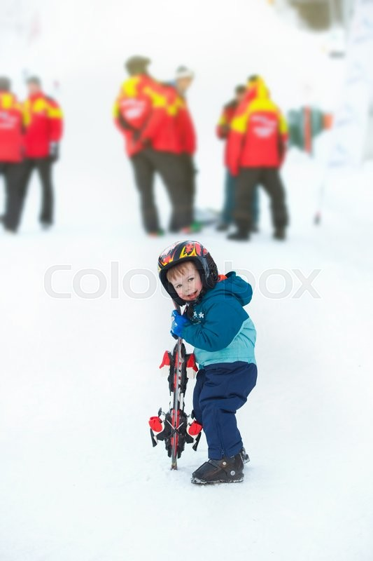 Stock image of 'toddler boy skiing in the mountains, winter time'