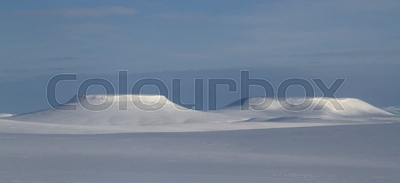 Stock image of 'winter panorama mesas on Bering Island winter sunny day'