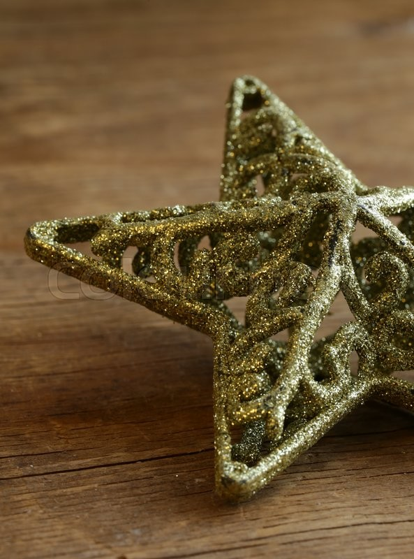 Stock image of 'Christmas vintage star on wooden background'