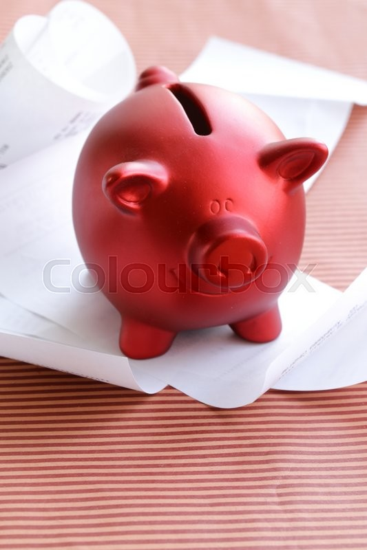 Stock image of 'funny red Pig Piggy with lots of receipt - saving concept'