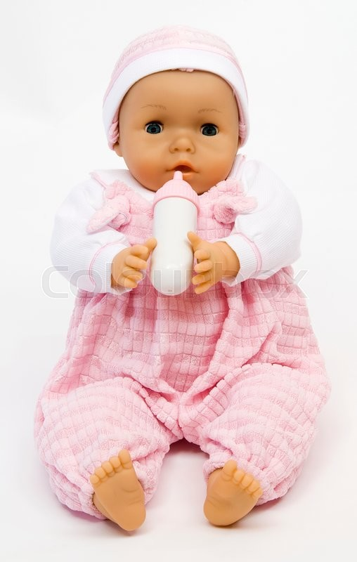 Stock image of 'Baby doll with a feeding bottle'