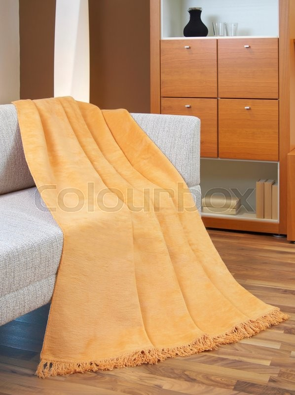 Stock image of 'Throw draped over a settee'