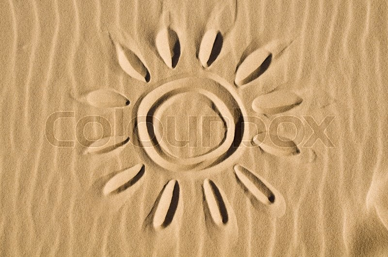 Stock image of 'Sun drawn in the sand'