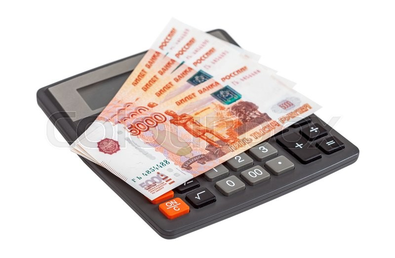 Stock image of 'Business concept. Russian ruble banknotes with calculator on a white background'