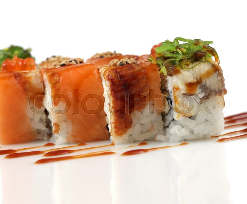 Stock image of 'Sushi rolls with salmon, eel fish, wakame seaweed on white'