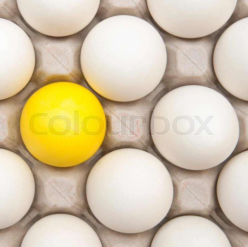 Stock image of 'white eggs with one gold egg'