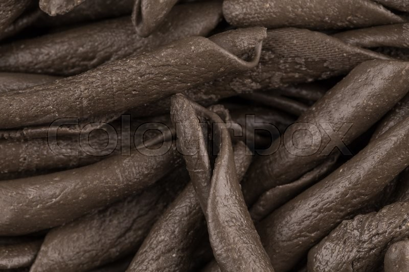Stock image of 'italian seppia pasta fusilli macaroni with cuttlefish ink, for background'