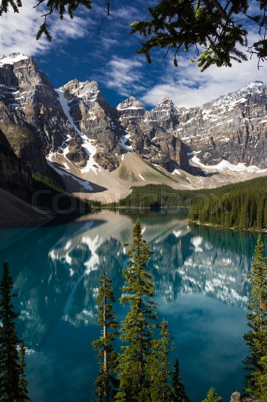 Stock image of 'A Look Through The Trees At Moraine Lake, Banff National Park, Alberta, Canada'