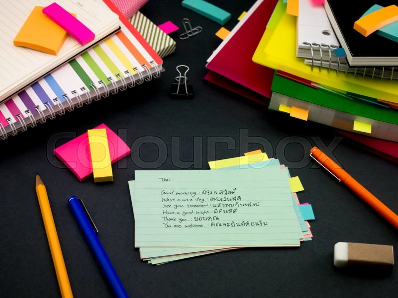 Stock image of 'Learning New Language Writing Words Many Times on the Notebook; Thai'