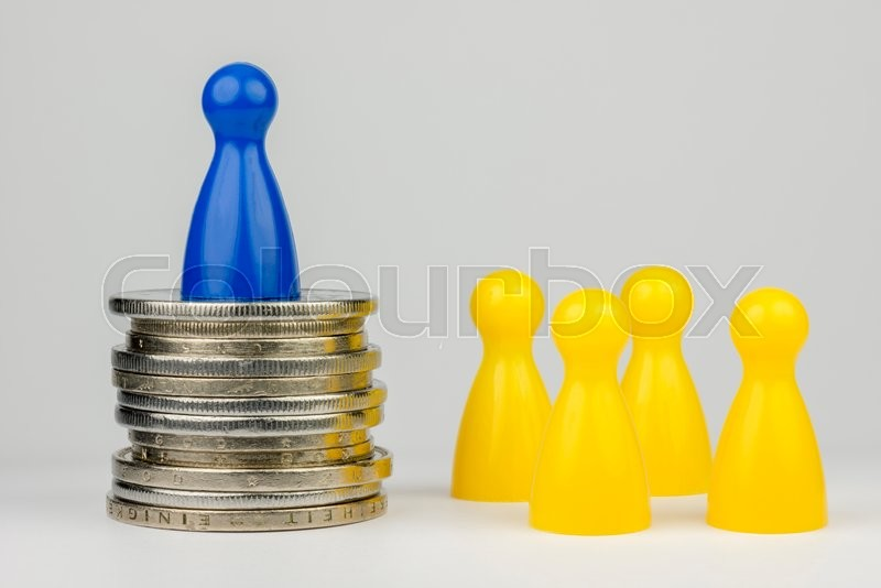 Stock image of 'Conceptual financial position represented with colored play pieces and coins\'