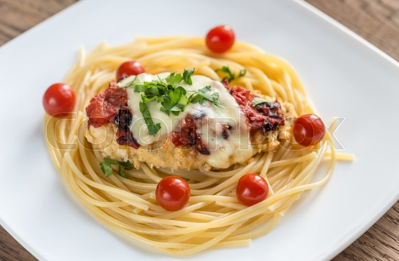Stock image of 'Baked chicken with parmesan and mozzarella'