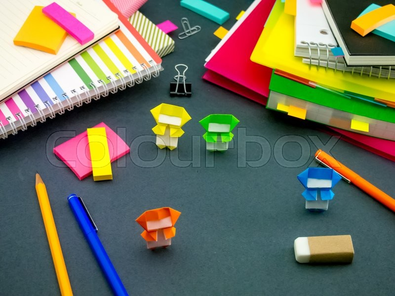 Stock image of 'Little Origami Ninjas Helping Your Work When You Are Sleeping at Your Desk'