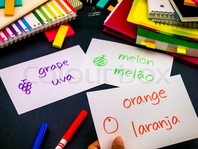 Stock image of 'Learning New Language Making Original Flash Cards; Portuguese'