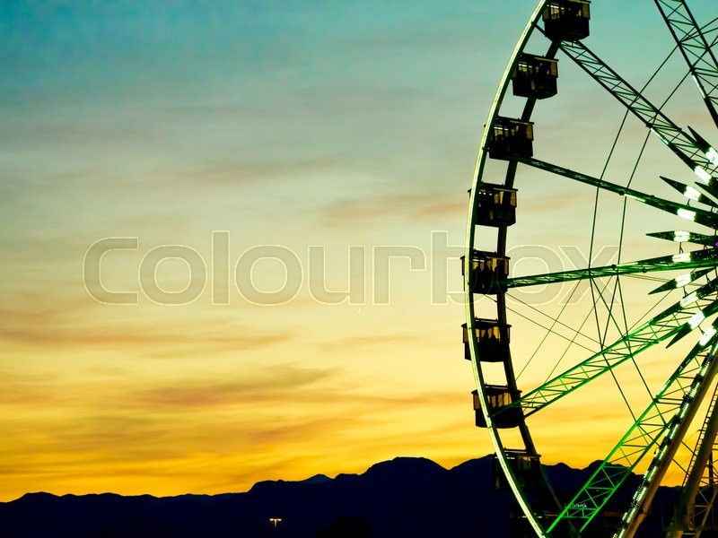 Stock image of 'Detail And Silhouette of Ferris Wheel with Sun Set'
