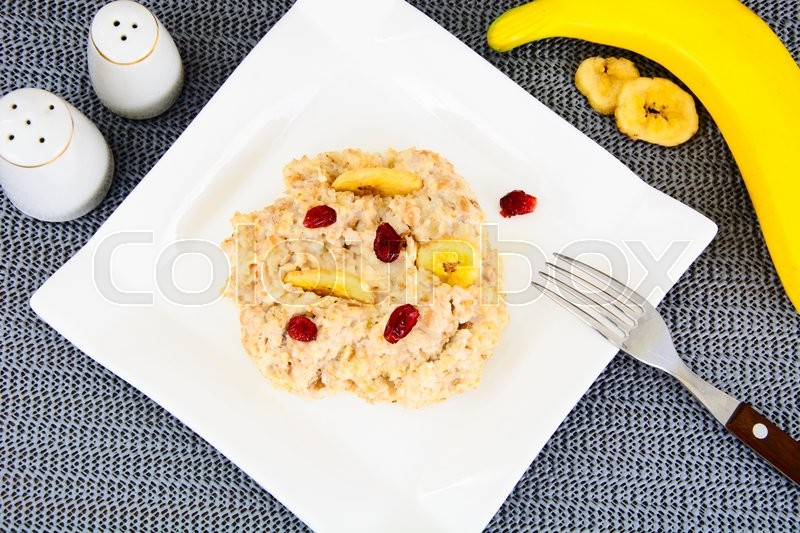 Stock image of 'Oatmeal Cranberry and Banana Health Diet Food Studio Photo'