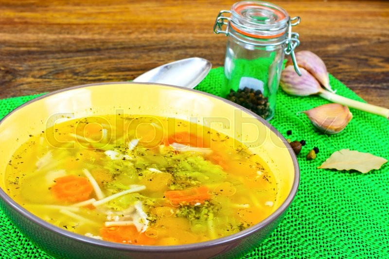 Stock image of 'Chicken Soup with Broccoli, Carrots and Celery, Pumpkin and Noodles Studio Photo'