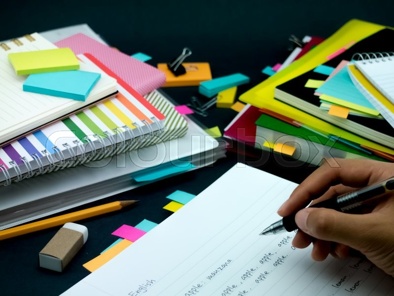 Stock image of 'Learning New Language Writing Words Many Times on the Notebook; English'