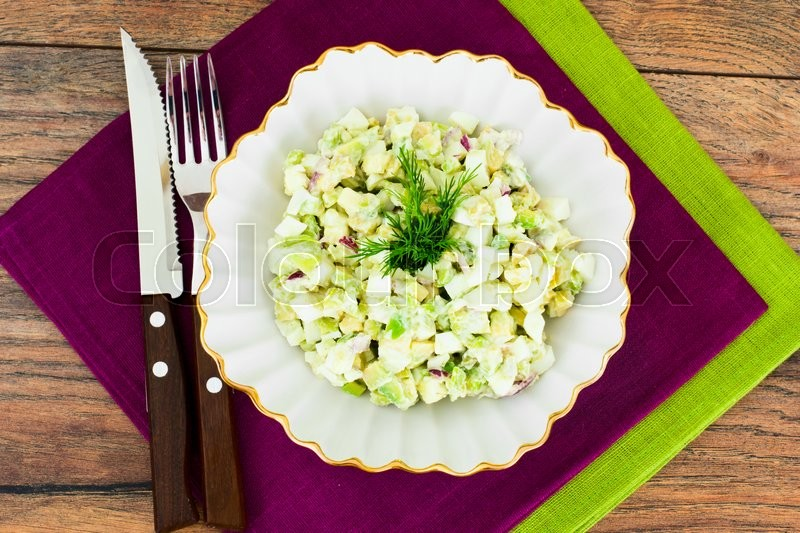 Stock image of 'Salad with Avocado, Boiled Eggs, Red Onion and Mayonnaise Studio Photo'