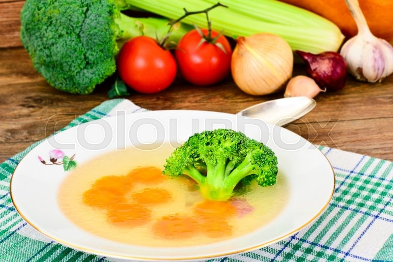 Stock image of 'Chicken Broth with Broccoli and Carrots Studio Photo'