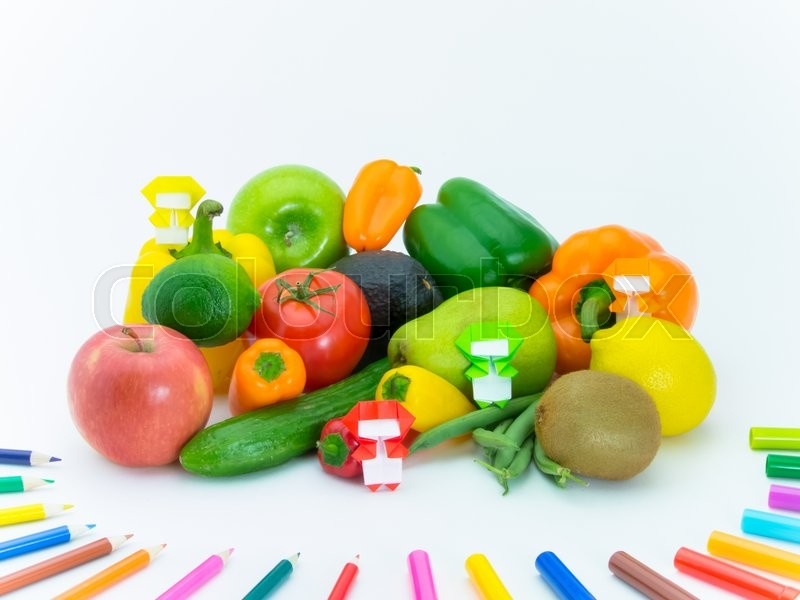 Stock image of 'Colorful origami Ninja playing with the vegetables and fruits.'
