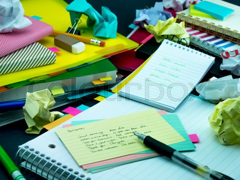 Stock image of 'Learning New Language Writing Words Many Times on the Notebook; Portuguese'