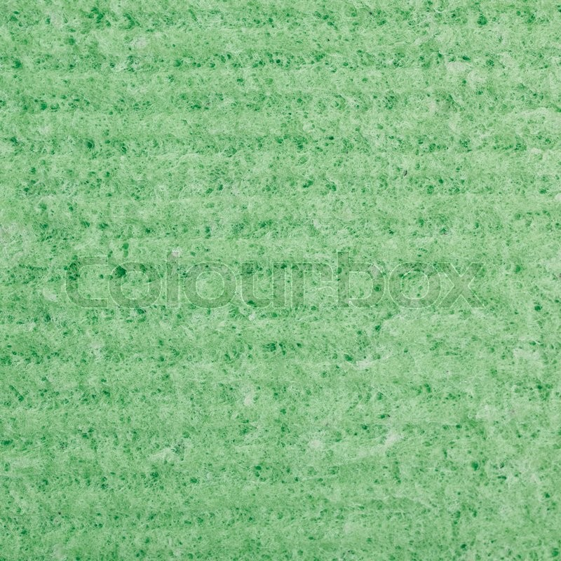 Stock image of 'Green kitchen wipe cloth close-up fragment as a background texture'
