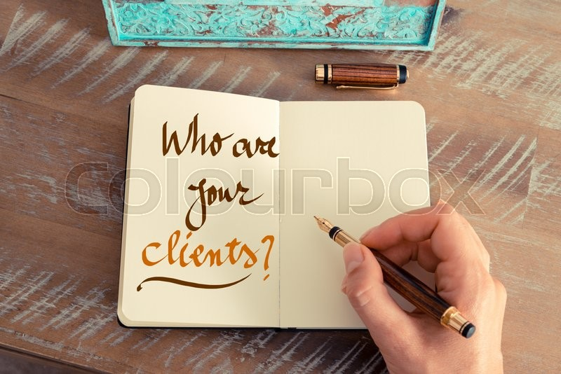 Stock image of 'Retro effect and toned image of a woman hand writing a note with a fountain pen on a notebook. Handwritten text WHO ARE YOUR CLIENTS ?, business success concept'