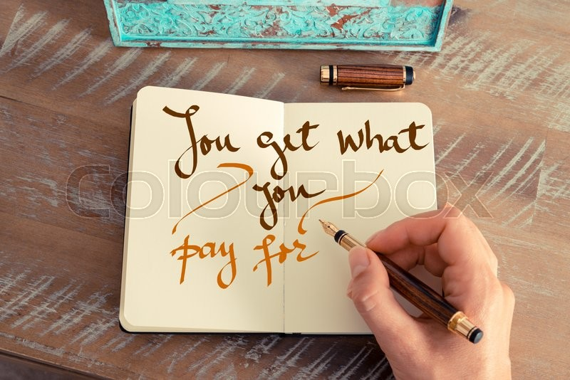 Stock image of 'Retro effect and toned image of a woman hand writing a note with a fountain pen on a notebook. Handwritten text YOU GET WHAT YOU PAY FOR, business success concept'