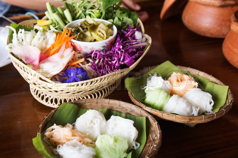 Stock image of 'Colorful Khanom Jeen / Thai rice noodle and vegetable'