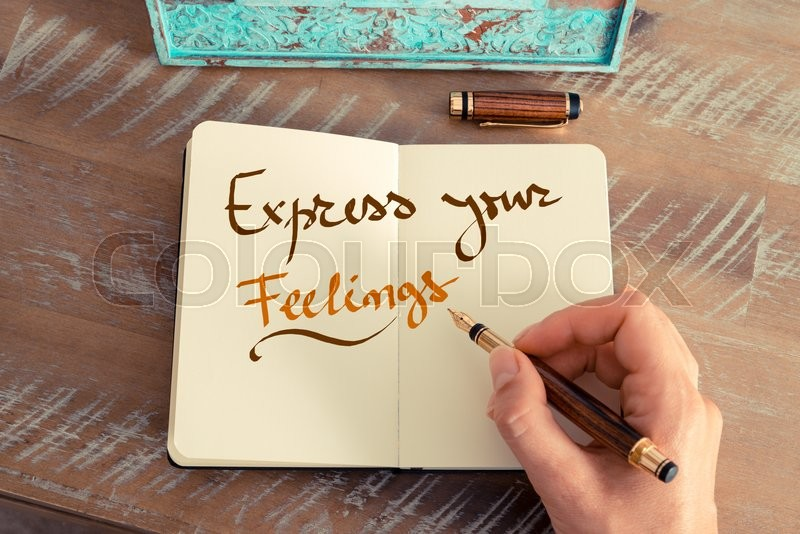 Stock image of 'Retro effect and toned image of a woman hand writing a note with a fountain pen on a notebook. Handwritten text EXPRESS YOUR FEELINGS, business success concept'