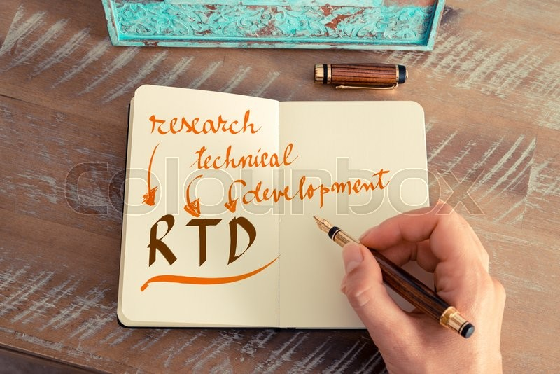 Stock image of 'Retro effect and toned image of a woman hand writing a note with a fountain pen on a notebook. Handwritten text RTD RESEARCH TECHNICAL DEVELOPMENT, business success concept'