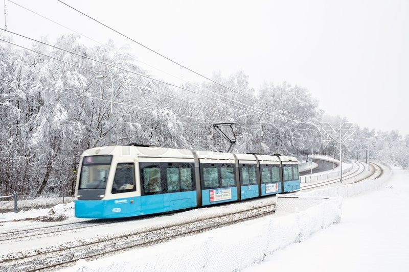 Editorial image of 'Modern tram from Gothenburg (Sweden) in snowy landscape with some motion blur.'