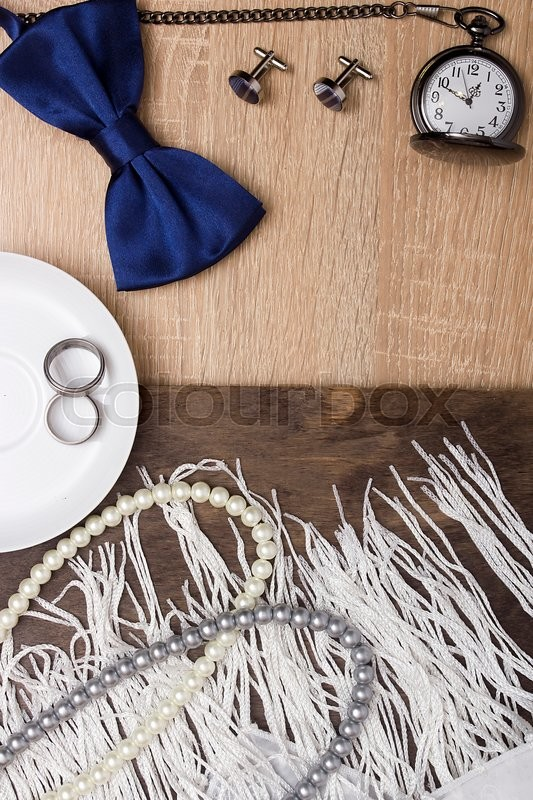 Stock image of 'Male and female wedding accessories with wedding rings.'