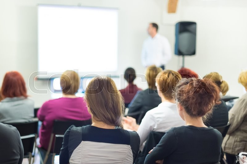 Stock image of 'Speaker at business workshop and presentation. Audience at the conference room.'