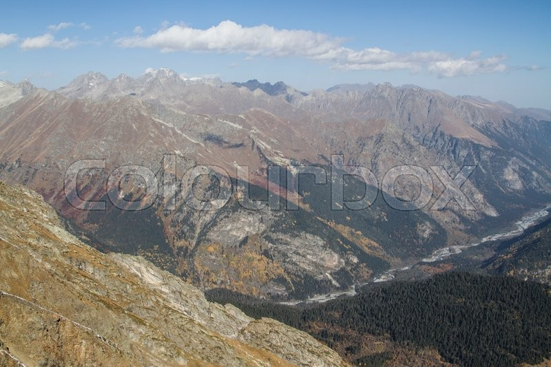 Stock image of 'Caucasus mountains near Dombay autumn day'