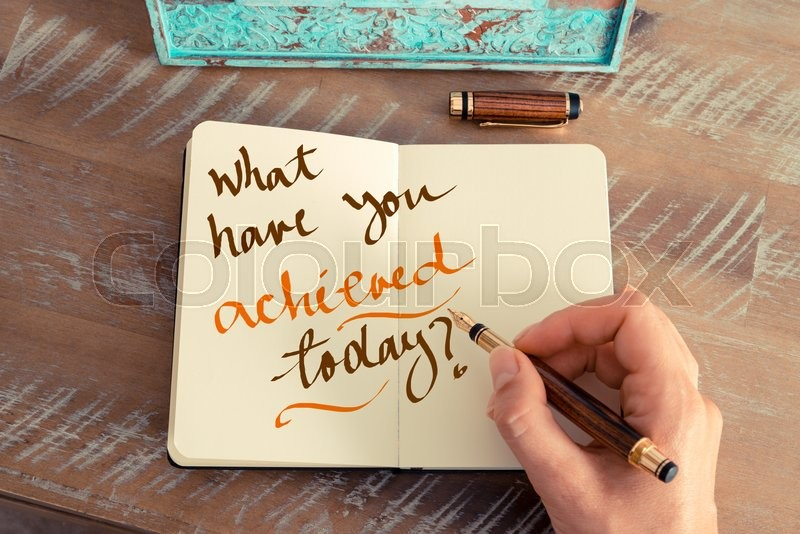 Stock image of 'Retro effect and toned image of a woman hand writing a note with a fountain pen on a notebook. Handwritten text WHAT HAVE YOU ACHIEVED TODAY ?, motivation concept'