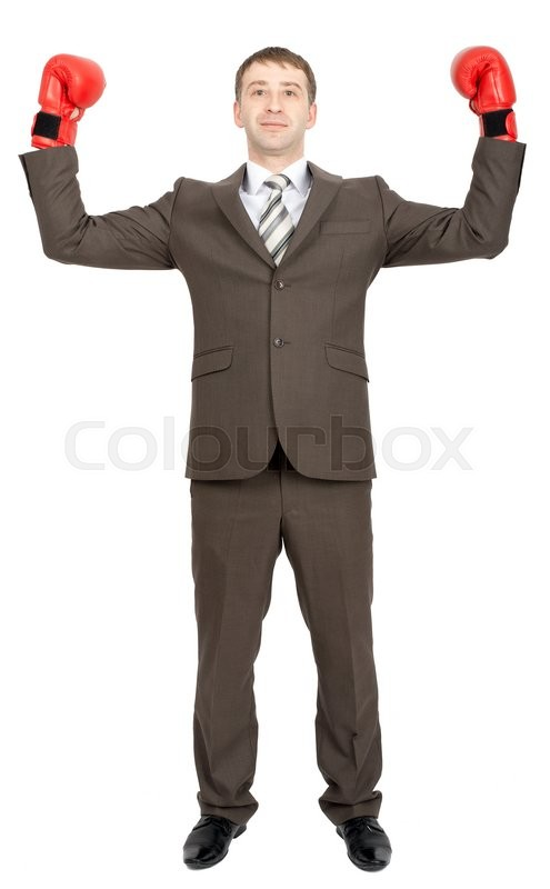 Stock image of 'Serious businessman with arms up in red boxing gloves  isolated on white background'