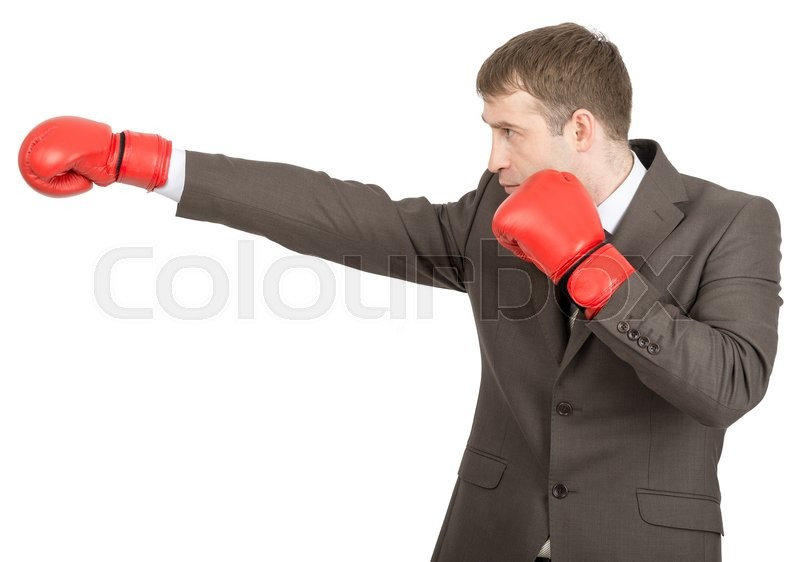 Stock image of 'Businessman in red boxing gloves isolated on white background, side view'