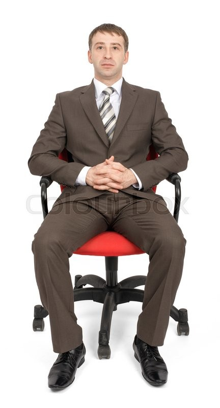 Stock image of 'Businessman sitting on chair and looking at camera isolated on white background'